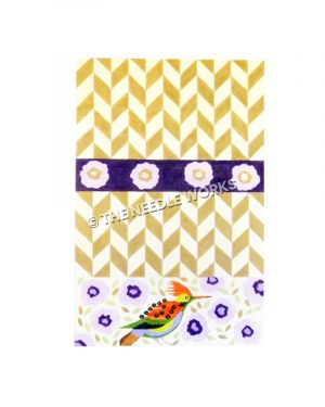 yellow and white clutch with purple flowers and orange, green and yellow bird