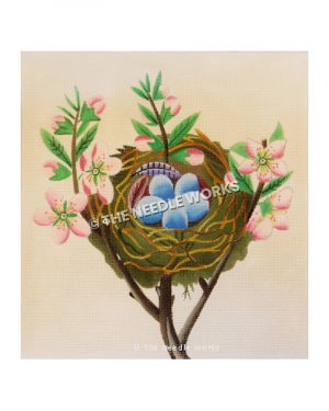 nest with robin's eggs and pink flowers