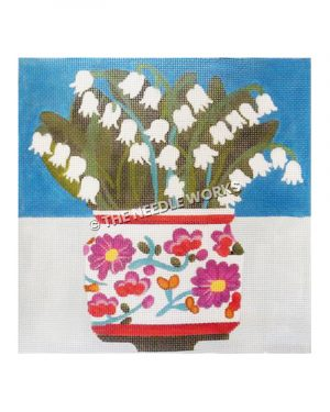 white flowers in white vase with pink flowered decoration