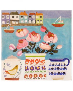 pink flowers on window sill with bay, boats and buildings in background