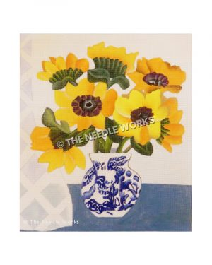 yellow flowers in white and blue vase