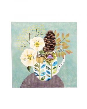 pine cone and flowers in white and blue pitcher