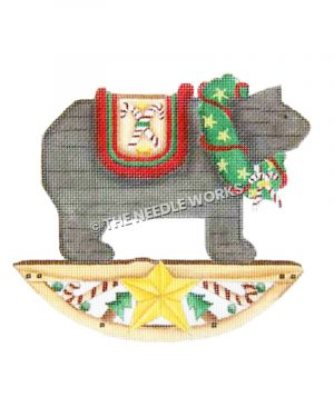 rocking bear on with wreath and candy cane decorations