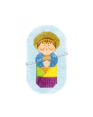 praying woman in patchwork dress