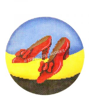 ornament with ruby red slippers on blue, yellow and black background