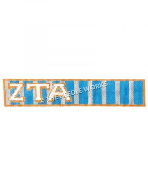 key fob with Zeta Tau Alpha white letters on blue and silver striped background