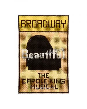 Broadway playbill cover with Beautiful The Carole King Musical written with grand piano