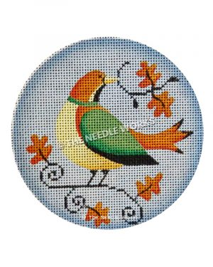 orange and yellow bird with green wings on round blue ornament with fall leaves and branches