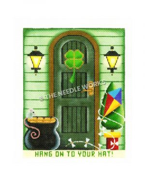 St. Patrick's Day themed house front with bag of gold and kite wrapped around tree beside door