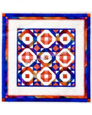 rainbow colored patchwork quilt on white with blue and pink border