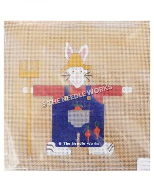 white farmer rabbit wearing blue overalls with carrots, yellow hat, and holding yellow pitchfork