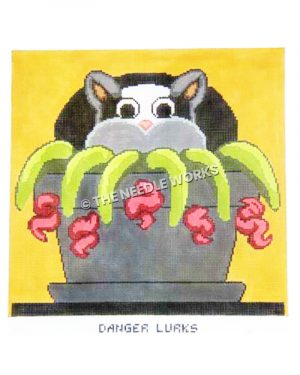 black and gray cat lurking in flower pot with red flowers