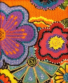 vivid purple, red, blue, orange and green beaded flowers