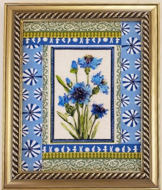 blue flowers on white rectangle with green, white, blue, and gold geometric patterned borders in gold frame