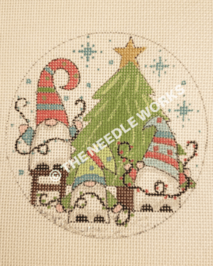 round ornament with gnomes decorating Christmas tree