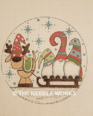 round ornament with three gnomes on sled with reindeer pulling sleigh