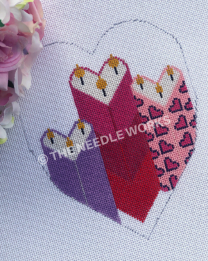 heart with three heart shaped candles in purple, red and pink striped, and pink heart pattern