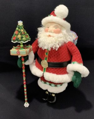 3D Santa with cane topped by rectangular box and Christmas tree