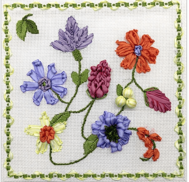 purple, pink, white and orange flowers with 3D decorative stitches on white background and green and white vine and ribbon border