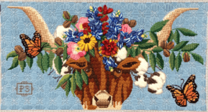 longhorn head with cotton and pecan branches and pink, yellow, red and blue flowers piled on head and yellow monarch butterflies flying around