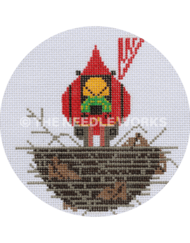 round ornament with cardinal in nest