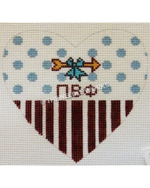 white heart with blue dots on top half and black stripes on bottom half and pi beta phi Greek letters with gold arrow