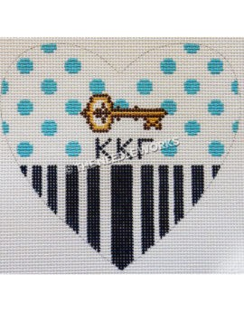 white heart with blue dots at top and black stripes on bottom half and gold key with kappa kappa gamma Greek letters