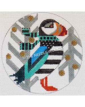 white round ornament with puffin wearing teal and black scarf and silver trees with gold round ornaments