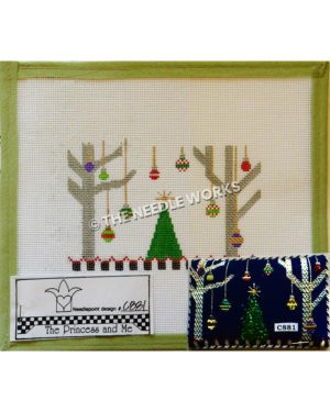 green Christmas tree with two silver trees on each side and long hanging ornaments from silver trees