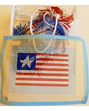 flag canvas with American flag pattern but one star and bag of red, white and blue yarn