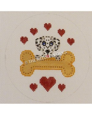 round white ornament with dalmatian face with yellow bone and red hearts