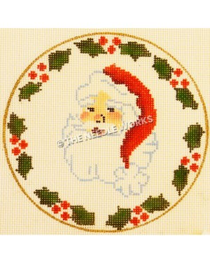 white ornament with Santa's face and border of holly leaves and berries