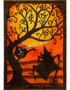 large full moon and orange background with tree silhouette, jack-o-lantern and witch kicking up heels