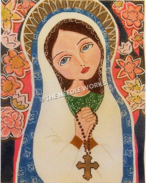 brunette woman in Catholic head covering with praying hands holding rosary and pink and yellow flowers in background