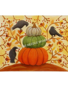 orange, green and white pumpkin stacked with yellow and orange flowers and branches in background and three crows perched