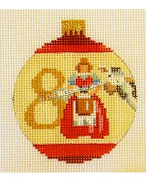 yellow and red ornament with maid milking next to cow and number 8 in gold