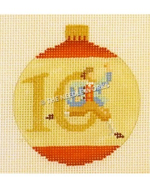 yellow and red ornament with 10 and lord leaping through the zero