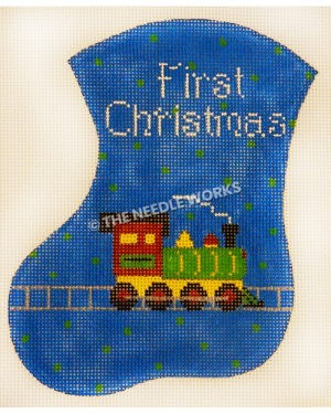 blue stocking with green polka dots with First Christmas in white and green, yellow and red train engine on track