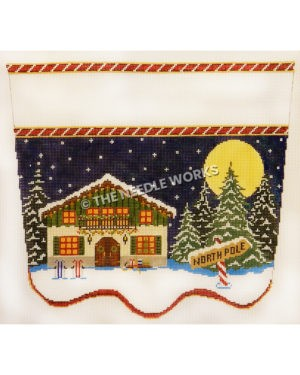 top of stocking with two story green building with red trim and candy cane North Pole sign with night starry sky, full moon and evergreen trees in snow