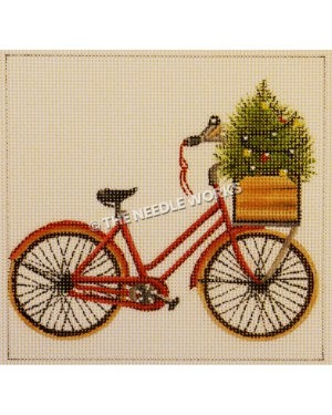 red bike with bird witting on handles and small Christmas tree in basket at front of bike