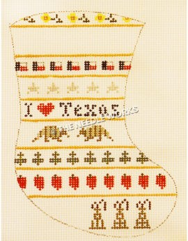 white stocking with I heart Texas in center, Texas flags, stars, armadillos, peppers, yellow roses, and oil derricks