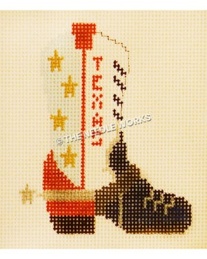 white boot with red heel and black toe and yellow stars and Texas in red on sides of boot with spur