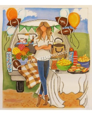 woman standing in front of tailgate filled with food, flowers, purse, and balloons in football shapes, orange and white