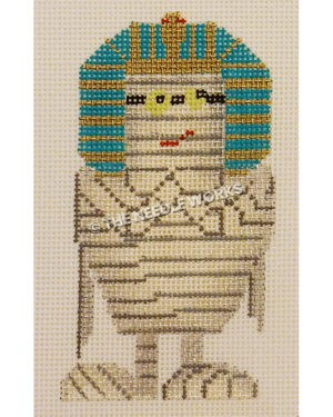 mummy with yellow eyes wearing a blue and gold Egyptian headdress