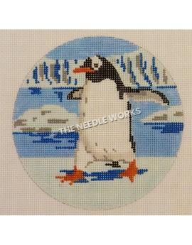 ornament with penguin strutting on snowy landscape with water and glaciers in background