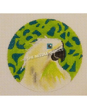 green ornament with abstract dark green pattern and white parrot with blue eye