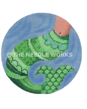 round ornament with green mermaids tail on blue background