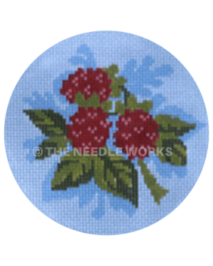blue ornament with bunch raspberries
