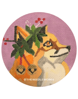 round ornament with fox wearing mistletoe and bells