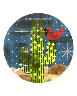 round ornament with red cardinal on cactus with night sky